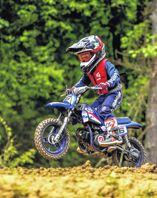 Five-year-old Kooper McKenzie competing in a race on his dirt bike this year.
