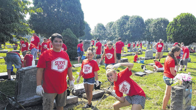 Members of the Portsmouth community participate in a previous Serve Day at Greenlawn Cemetery.