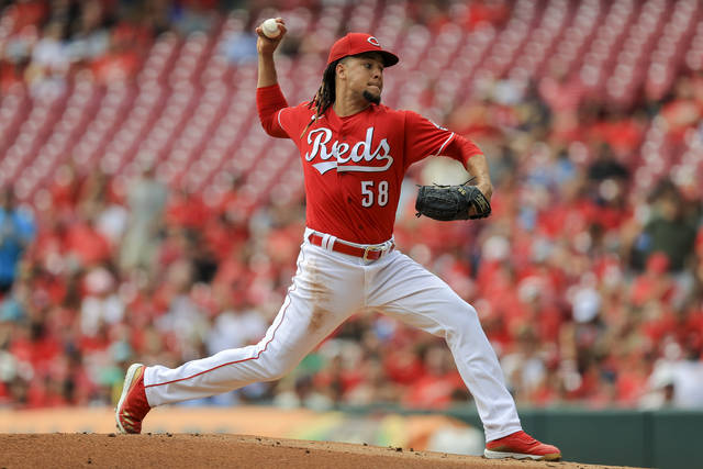 Cincinnati Reds' Luis Castillo throws during the first inning of a baseball game against the Minnesota Twins in Cincinnati, Wednesday, Aug. 4, 2021. (AP Photo/Aaron Doster)