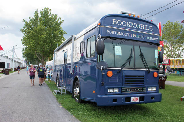 The Portsmouth Public Library Bookmobile was set up at the county fair giving children a chance to pick out a book and play games during the week.