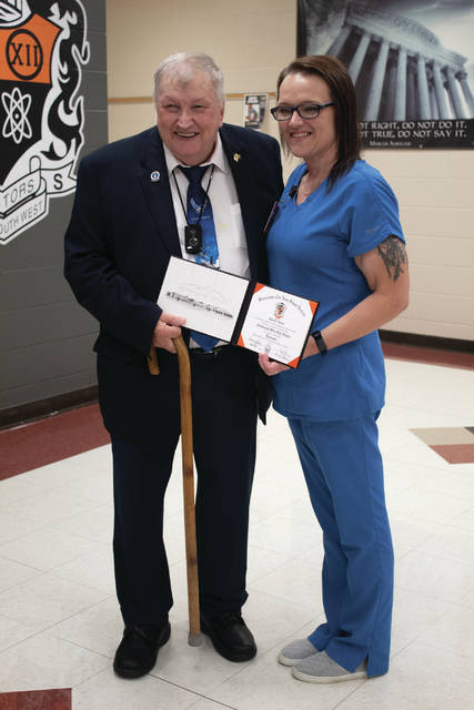 John Foster and Melissa Timberlake pose together after Foster was awarded his diploma.