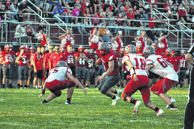 Minford sophomore Jeffrey Pica (1) had 15 carries for 73 yards in the Falcons' season-opening home game versus Piketon at Minford Stadium.