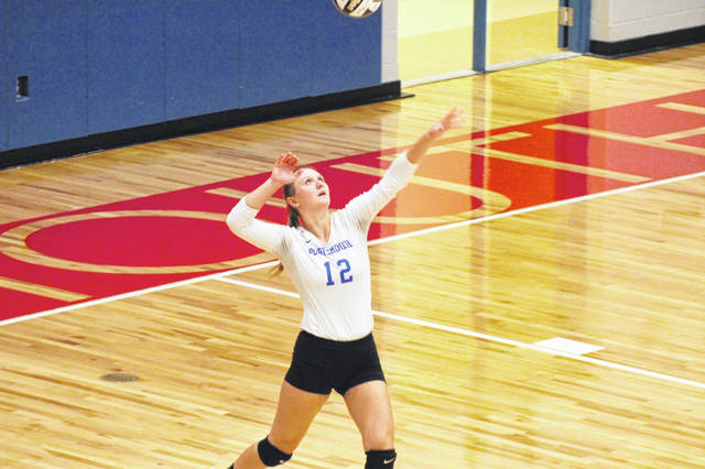 Portsmouth senior Madison Perry (12) had a team-high 17 kills in the Lady Trojans' 3-0 wn over Manchester inside Trojan Arena.