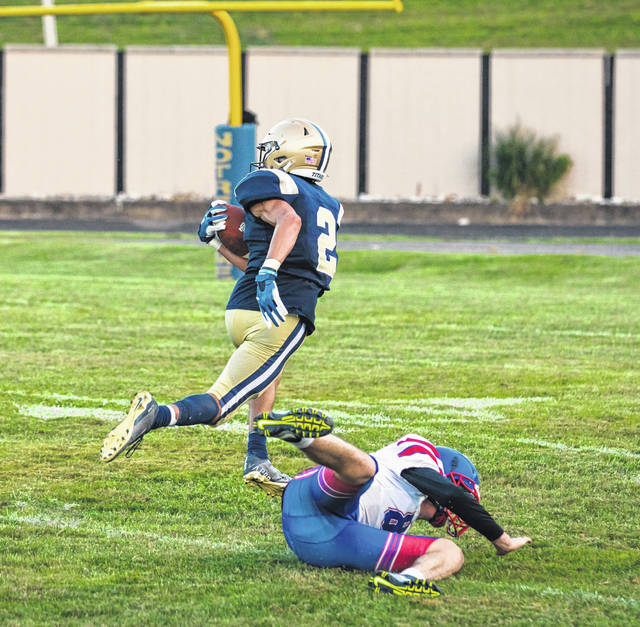 Notre Dame's Dylan Seison (2) escapes a tackle on his way to scoring a first-half touchdown during the Titans' 50-20 season-opening football victory over Lewis County (Ky.) on Monday night.