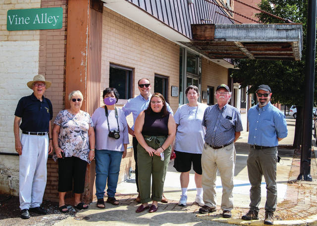 Member of The Scioto County Heritage Museum and The Ohio Historical Museum pose for a photo on August 10 after discussing future plans for the museum.