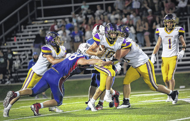 Valley quarterback Carter Nickel (10) rushed 14 times for 26 yards and threw for 174 yards and two touchdown passes in the Indians' 28-21 come-from-behind football win on Friday night.