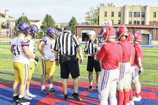 Portsmouth's and Valley's team captains met at midfield for the pregame coin toss prior to opening kickoff inside Trojan Coliseum on Thursday.