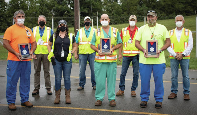 Three employees of Fluor-BWXT Portsmouth, LLC, recently received Fluor's prestigious Medal of Safety for Life-Saving Actions. Bryan Cornett, Cecil McCoy and Jimmy Nichols were honored during a brief ceremony on Aug. 18, 2021. Pictured, from left, are McCoy; JD Dowell, FBP Site Project Director; Marsha McRoberts; Brian Clayman, FBP Waste Management Director; Nichols; Chris Lewis, FBP Waste Operations Manager; Cornett; and Harry Gulley, FBP Environmental Safety, Health and Quality Director.