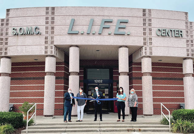 Ribbon cutting for the grand reopening for the Portsmouth SOMC Life Center