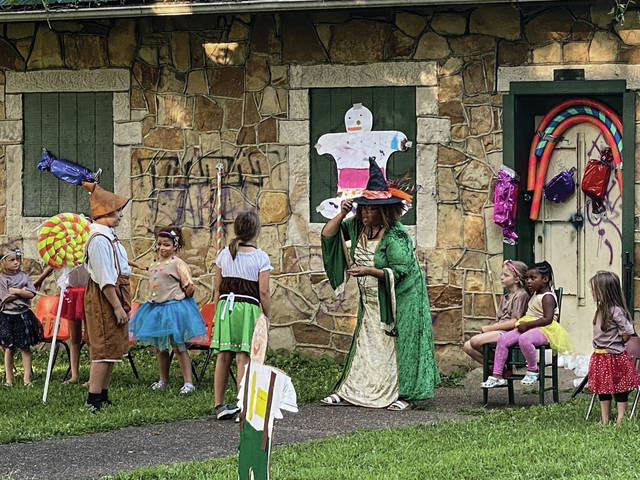 Children at the 14th Street Community Center participated in a production of several fairy tales at Mound Park Friday. The production included tales from Frozen, The Big Bad Wolf, Hansel and Gretal, and the Three Little Pigs.