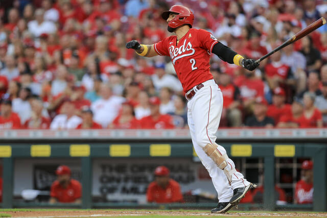 Cincinnati Reds' Nick Castellanos watches his grand slam during the second inning of the second baseball game of the team's doubleheader against the St. Louis Cardinals in Cincinnati, Wednesday, Sept. 1, 2021. (AP Photo/Aaron Doster)