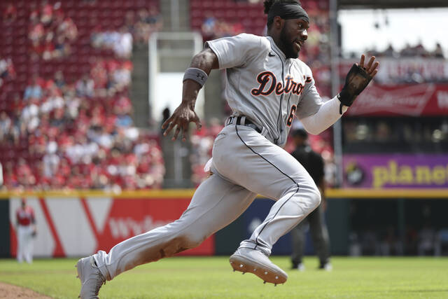 Detroit Tigers baserunner Akil Baddoo (60) rounds third on his way to scoring on a ball off the bat of Jonathan Schoop during the eighth inning of a baseball game, Sunday, Sept. 5, 2021, in Cincinnati. (AP Photo/Gary Landers)