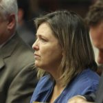 Woman is 2nd to admit role in death of 8 members of a family
