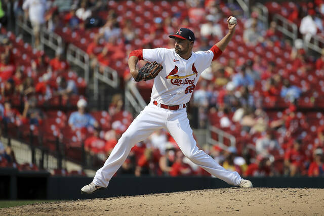 St. Louis Cardinals relief pitcher T.J. McFarland delivers during the seventh inning of a baseball game against the Cincinnati Reds, Sunday, Sept. 12, 2021, in St. Louis. (AP Photo/Scott Kane)