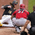 Mahle, Reds blank Pirates to avoid sweep