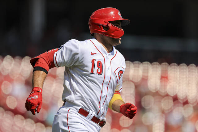 Cincinnati Reds' Joey Votto runs the bases after hitting a two-run home run during the first inning of a baseball game against the Pittsburgh Pirates in Cincinnati, Monday, Sept. 27, 2021. (AP Photo/Aaron Doster)