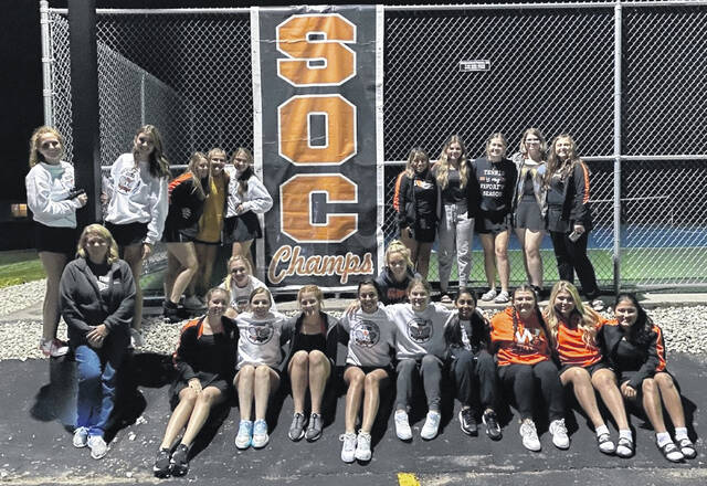 The Wheelersburg High School girls tennis team, coached by Jodi Wright (front left), captured the 2021 outright Southern Ohio Conference championship on Thursday night.