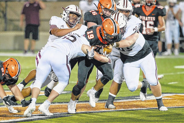 Wheelersburg senior Casey Doerr (19) carries the ball against Pikeville during Friday night's non-league football game at Wheelersburg High School's Ed Miller Stadium.