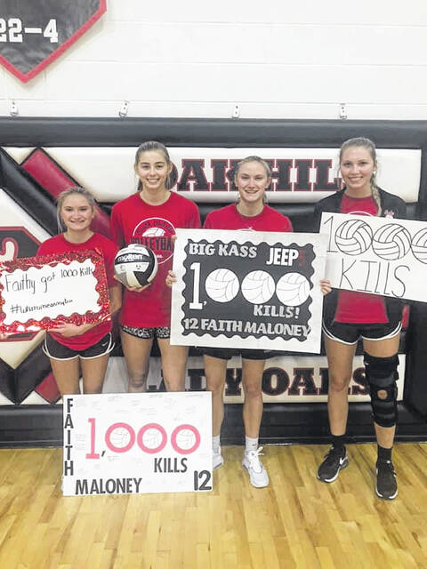 South Webster's senior class (L-R) Graci Claxon, Faith Maloney, Bri Claxon and Rylee McGraw help celebrate Maloney recording her 1,000th career kill during her Lady Jeep varsity career.