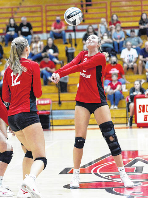 South Webster senior Rylee McGraw (9) returns a serve as teammate Faith Maloney (12) looks on during the Jeeps' non-league volleyball match against Gallia Academy on Monday night at South Webster High School.