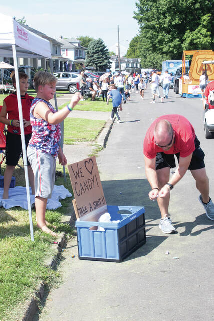 Residents found creative ways to collect candy during the annual River Days Parade on Saturday.