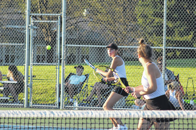Wheelersburg junior Emily Janney and senior doubles partner Maegan Jolly compete in Thursday's Southern Ohio Conference girls tennis match against Waverly at Wheelersburg High School.