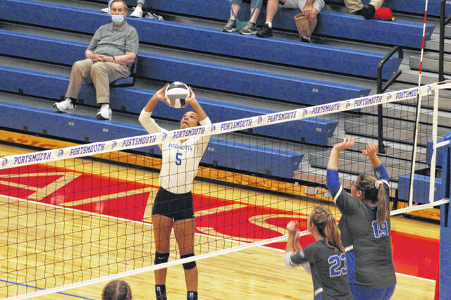 Portsmouth volleyball's Maysa Calvin (5) attempts a set during the Lady Trojans' loss to Gallia Academy inside Trojan Arena.