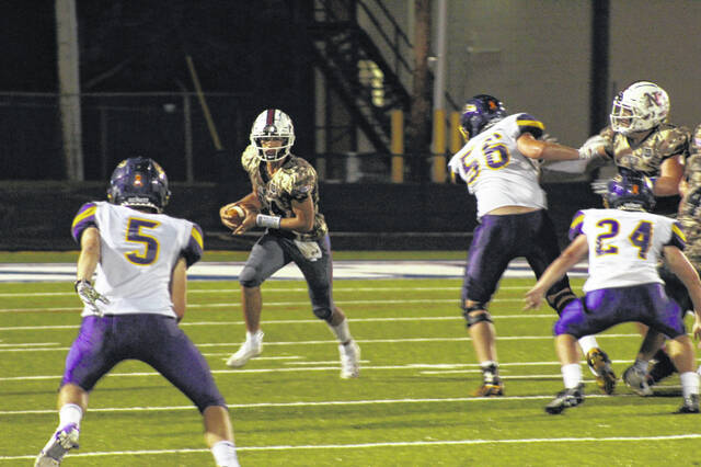 Northwest senior quarterback Austin Newman (14) led the Mohawks in rushing with 91 yards and a touchdown during their week five meeting with Valley.