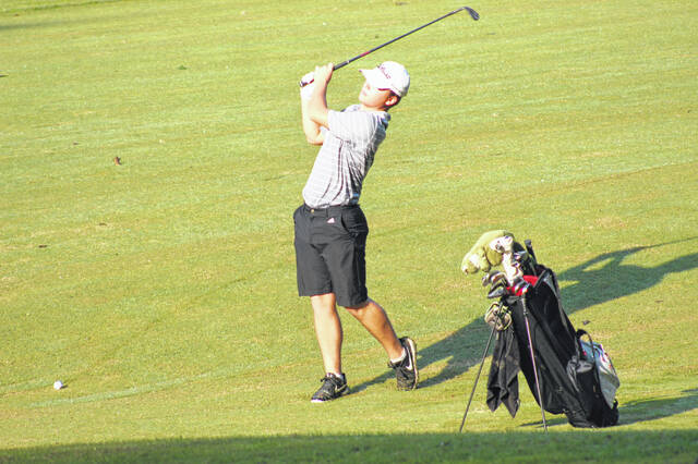 Minford senior Dillon Osborne attempts a fairway approach shot during Tuesday's Division II boys golf sectional tournament at The Elks Country Club.