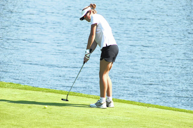 South Webster sophomore Ava Messer putts from the edge of the green on Hole No. 4 at The Elks Country Club during Tuesday's Southern Ohio Conference golf championships.