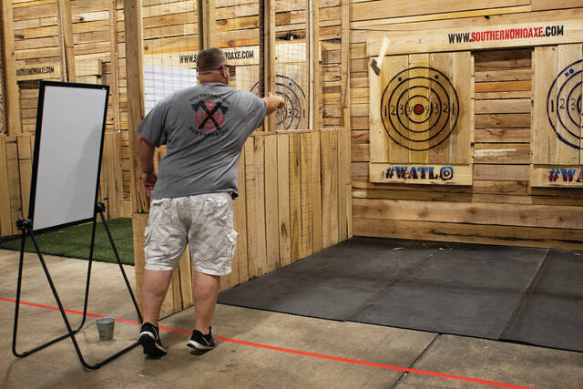 Owner, Ron Ward demonstrates how to properly throw an axe at Southern Ohio Axe Throwing.