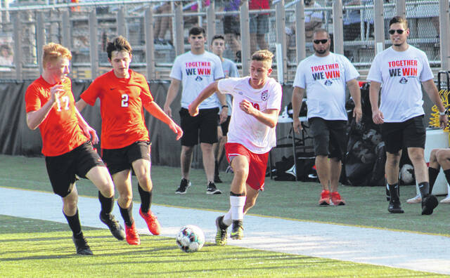 Wheelersburg's Tyler Sommer (17) and Max Hagans (2) battle Minford's Myles Montgomery (10) for possession of the ball during Tuesday's Southern Ohio Conference Division II boys soccer match at Wheelersburg's Ed Miller Stadium.