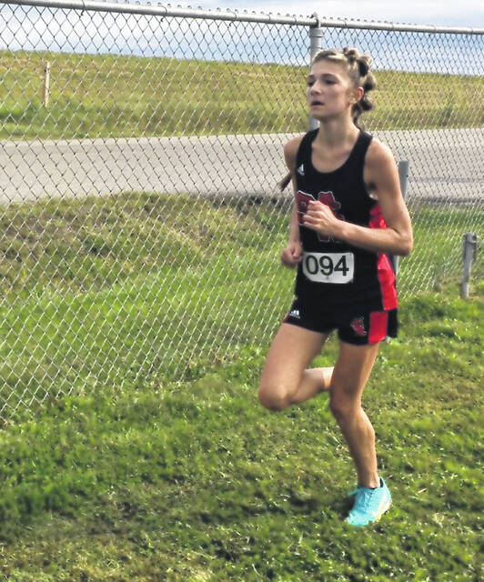 South Webster's Marley Kreischer finished fourth and paced the Lady Jeeps to the girls team championship as part of Saturday's annual Minford Invitational cross country meet.