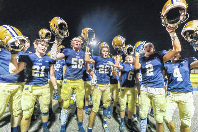 Members of the Notre Dame Titans celebrate their 27-21 non-league come-from-behind football victory over visiting Fayetteville on Friday night at Spartan Municipal Stadium.