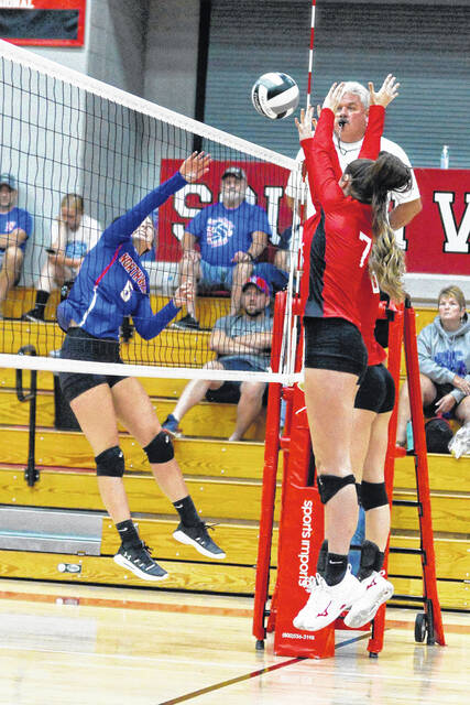 Northwest senior hitter Audrey Knittel (6) goes up for a kill against South Webster's Natalie Adkins (7) during Thursday night's Southern Ohio Conference Division II volleyball match at South Webster High School.