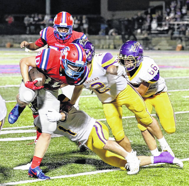 Portsmouth wideout Jayden Duncan (80), shown here against Valley in the Trojans' season opener, has provided another offensive option for standout quarterback Drew Roe.