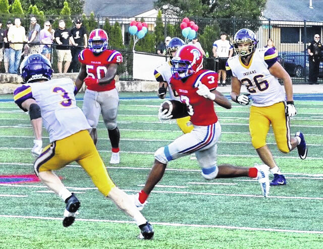 Portsmouth wideout Dariyonne Bryant (3), shown here against Valley in the Trojans' season opener, has provided another offensive weapon for standout quarterback Drew Roe.