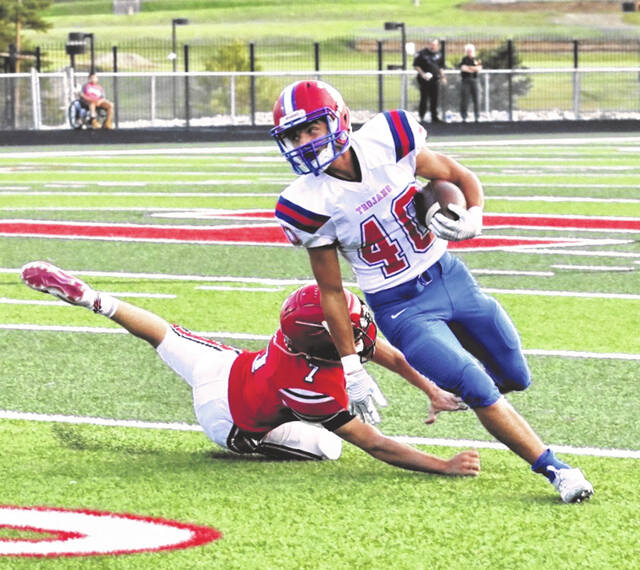Portsmouth wideout Reade Pendleton (40), shown here against Rock Hill last week, has provided another offensive weapon for standout quarterback Drew Roe.