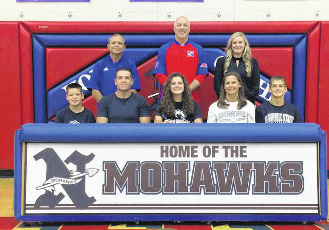 Northwest High School's Reagan Lewis, seated center, announces her intention to play collegiate volleyball at Shawnee State University. Seated with Lewis are, from left, brother Luke Lewis, father Nick Lewis, mother and Northwest High School volleyball head coach Elizabeth Lewis and brother Caleb Lewis. Standing are, from left, Northwest High School Athletic Director Dave Frantz, Northwest High School Principal Rick Scarberry and Shawnee State University volleyball head coach Devan Scarberry.