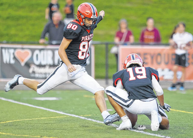 Wheelersburg senior kicker Braxton Sammons (80) went a perfect 5-of-5 on extra-point attempts in the Pirates' 35-16 non-league football victory over Russell on Friday night at Wheelersburg's Ed Miller Stadium.