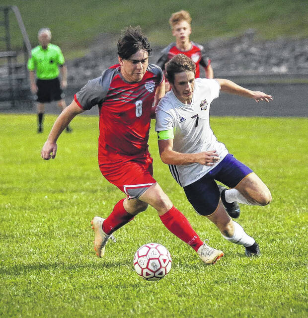 Minford senior Jacob Lewis (8) and Valley senior Austin Sommers (7) battle for a loose ball during Monday night's non-league boys soccer match at Minford High School.