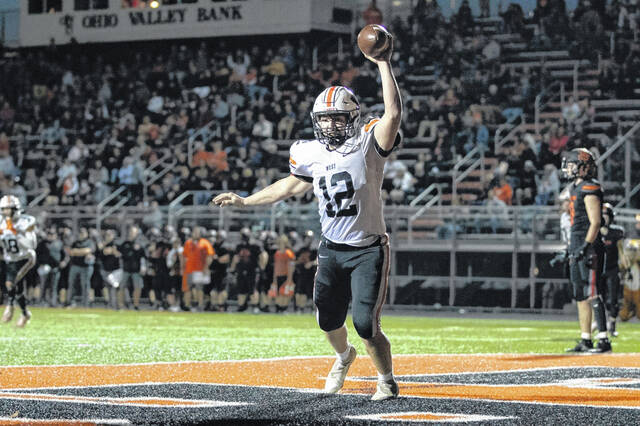 West senior Ashton Klaiber (12) caught a 6-yard touchdown pass from Mitchell Irwin with 18 seconds left before halftime in the Senators' SOC II opener versus Waverly.