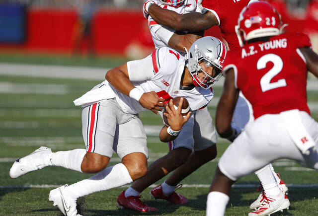 Ohio State quarterback C.J. Stroud (7) rushes against Rutgers defensive back Avery Young (2) during an NCAA college football game, Saturday, Oct. 2, 2021, in Piscataway, N.J (AP Photo/Noah K. Murray)