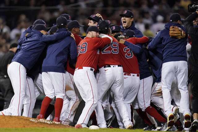 The Boston Red Sox celebrate after they defeated the New York Yankees 6-2 in an American League Wild Card playoff baseball game at Fenway Park, Tuesday, Oct. 5, 2021, in Boston. (AP Photo/Charles Krupa)