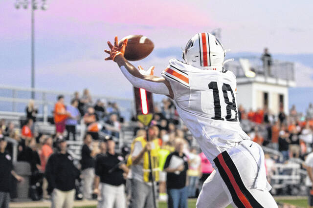 Portsmouth West sophomore Jeffery Bishop (18) hauled in two touchdown receptions on passes from junior quarterback Mitchell Irwin during the Senators' 44-14 win over Valley in SOC II play.