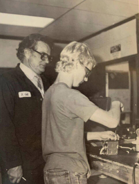 Ralph Gill helping a student while teaching at Scioto County Career Technical Center in 1987.