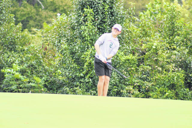 Valley freshman Cameron Phillips attempts a chip shot during his round at last week's SOC Golf Championships at The Elks Country Club.