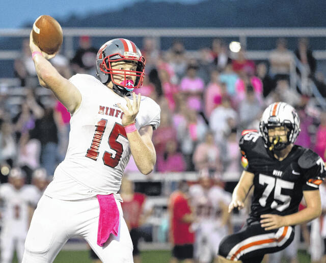 Minford quarterback Devin Parker (15) passed for 155 yards and two touchdowns and rushed for 112 yards and one TD during the Falcons' 41-21 victory over West on Saturday night at Valley High School.