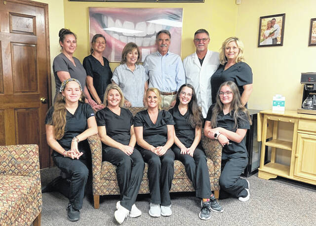 This photo is taken of Dr. Murray's wonderful staff along with the Murrays and the Hunters. In the back row, right to left, is Rhonda Murray, Dr. Tracy Murray, Mark Hunter and Virgie Hunter.