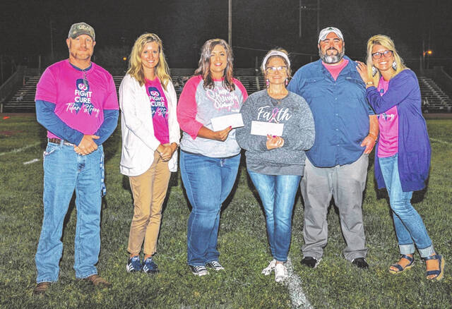 Left to right: JD McKenzie-Principal of NDHS , Jessica Nolan-Development Director Assistant, Carrie Bennett-employee of KDMC and Notre Dame Alumni , Traci Boland-Notre Dame parent whose mother is a breast cancer survivor, Curtis Metzler- Vice President of patient care services at KDMC and brother to Principal of Notre Dame Elementary, Michelle Ashley -Principal of Notre Dame Elementary and breast cancer survivor.